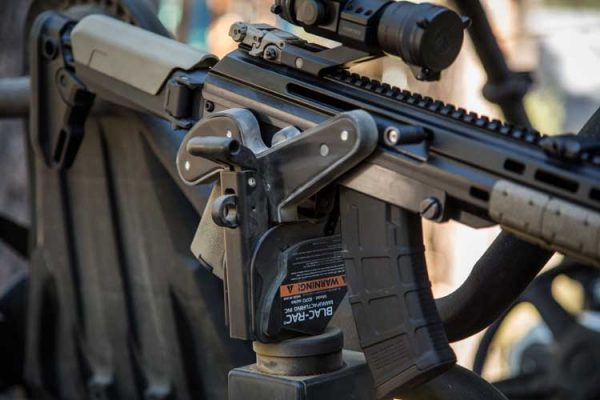 Blac-Rac 1070 Weapon Retention System holds an AK style rife installed in a UTV.
