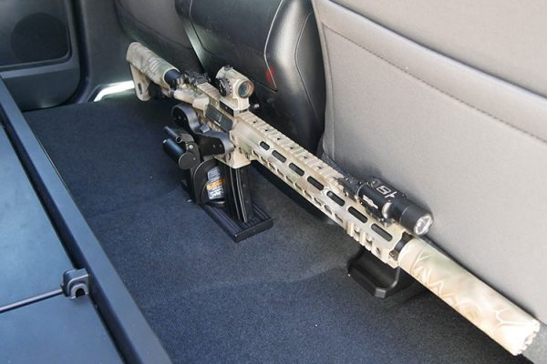 "An AR-15 is held in a Blac-Rac 1070 with an integral lock on a 10"" T-channel. The T-Channel is mounted to the floor of a Toyota Tundra pickup truck."