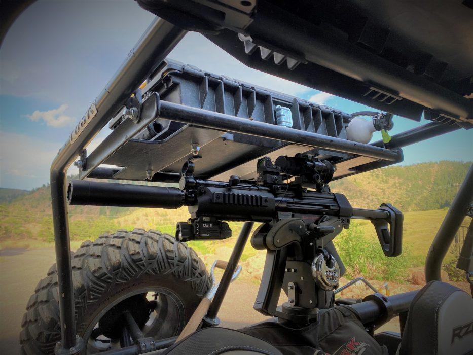 rear mounted 1070 gun rack holding mp5 in utv