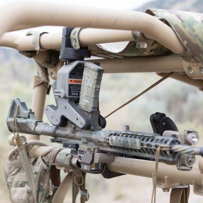 1082 gun rack mounted overhead in utv holding ar15