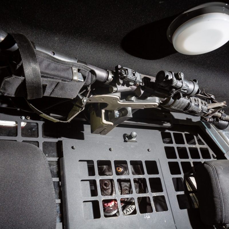 A Blac-Rac 1082 weapon retention system is mounted in a police K9 crusier
