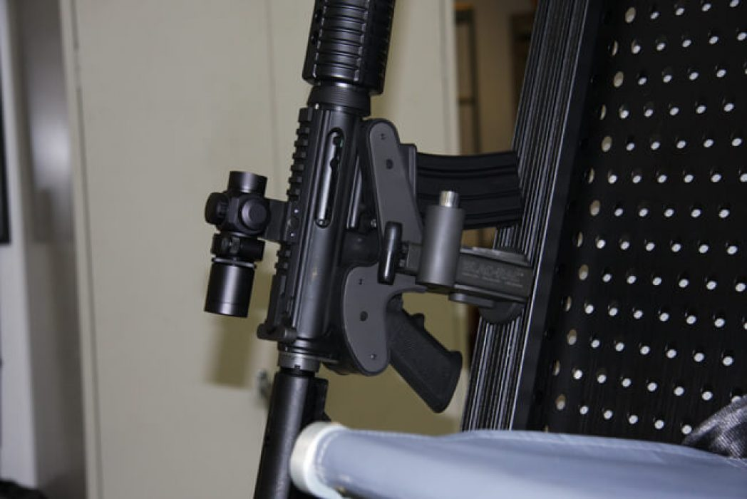 A replica M4 rifle is mounted in a Blac-Rac 1070. The rifle is mounted in a A-Star A350B3 helicopter.