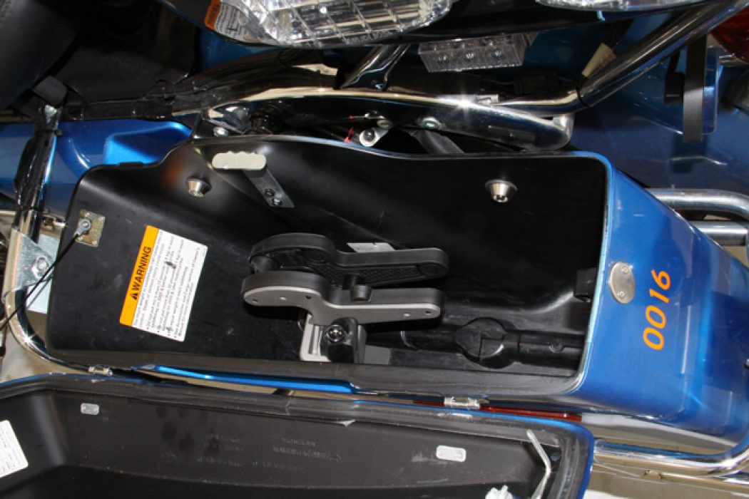 A Blac-Rac 1082 weapon retention system is installed in a Harley Davidson police motorcycle in the left-side saddlebag.