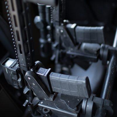 dual 1070 gun racks mounted in rzr utv holding ar15
