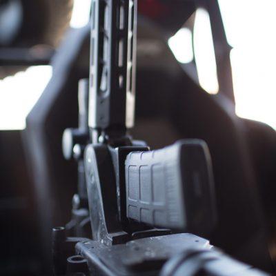 1070 gun rack mounted in rzr utv holding ar15