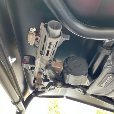 1070 gun rack mounted overhead in utv holding maxim pdx with drum