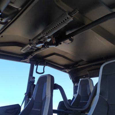 1070 gun rack with daniel defense mk18 overhead in wolverine utv