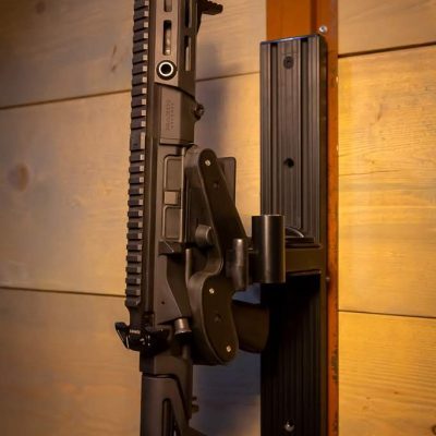 a wall mounted t-channel with a locked 1070 gun rack holding maxim pdx