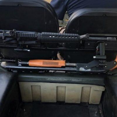 dual 1070 gun rack mounted in argo utility vehicle holding shotgun and ar15