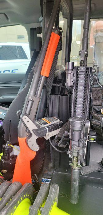 a police cruiser has 2 1082 gun racks the first has a remington 870 and the second an ar15 \