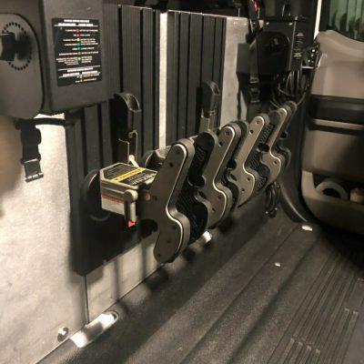 multiple 1082 gun racks mounted in back of truck