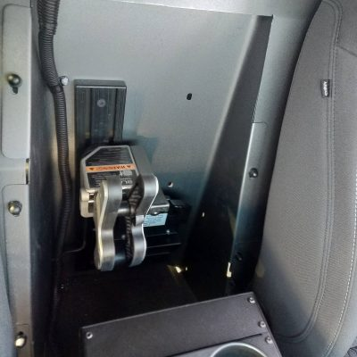 partition mounted 1082 gun rack in police cruiser