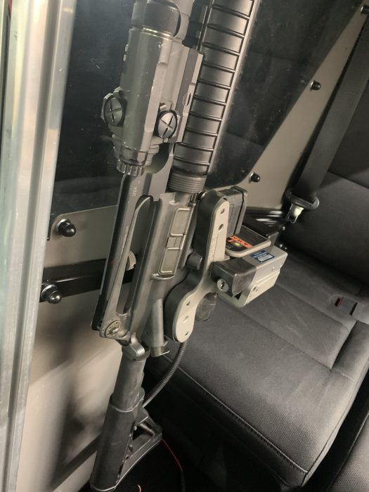 1082 gun rack mounted to partition holding ar15