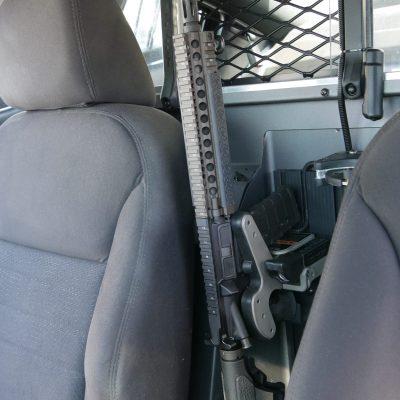 1082 gun rack mounted on partition of police cruiser