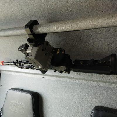 overhead mounted 1082 in swat van securing a replica ar15