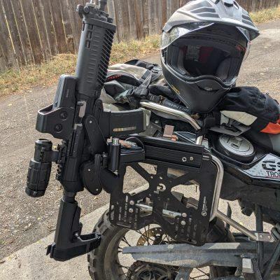 1070 gun rack mounted to bmw adventure motorcycle holding ar pistol